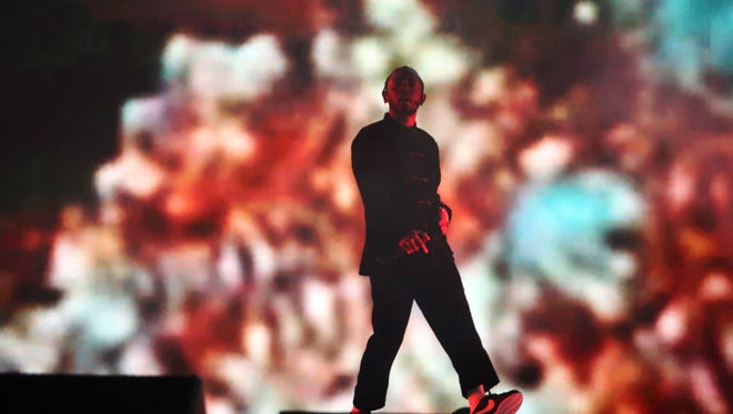 Apr 16, 2017; Indio, CA, USA; Kendrick Lamar performs on the Coachella Stage during the Coachella Valley Music and Arts Festival at Empire Polo Club. Mandatory Credit: Richard Lui/The Desert Sun via USA TODAY NETWORK