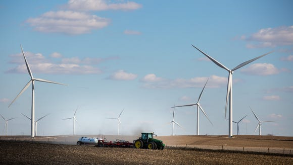 Wind turbines fill the horizon near Ida Grove Thursday,