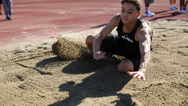 Xavier College Prep's Jonathan Smith compete in the long jump on Thursday, April 20, 2017 during a track meet with Shadow Hills in Indio.