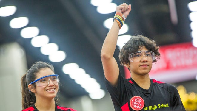 Immokalee High School Robotics Team seniors Jenni Villa, left, and Kristian Trevino celebrate winning a match during the Vex Robotics Competition World Championship in Louisville, Ky. on Thursday, April 20, 2017. This is day one of three days of competition for the students.