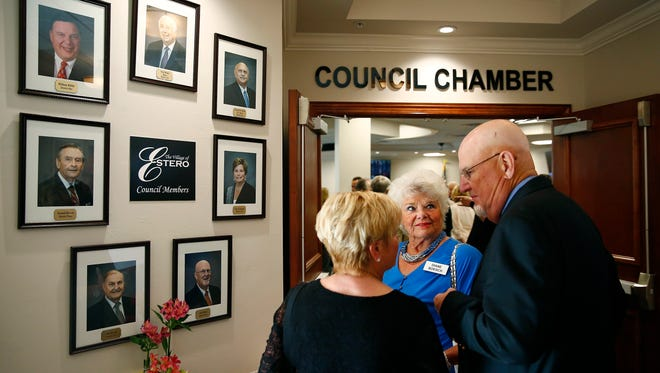 In this file photo, Diane Boesch, center, listens to Charlene Wilson, left, and Estero Councilor Jim Wilson at a ribbon cutting ceremony last April for the newly-renovated Village Hall.