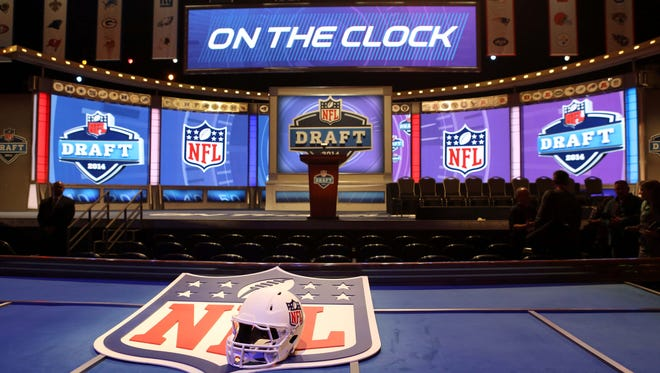 A general view of a helmet, NFL shield, stage, and podium before the start of the 2014 NFL Draft at Radio City Music Hall.