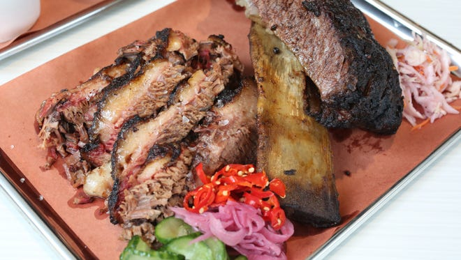 Brisket and a brontosaurus rib from Mighty Quinn's  at Savor at The Westchester in White Plains, April 26, 2017.