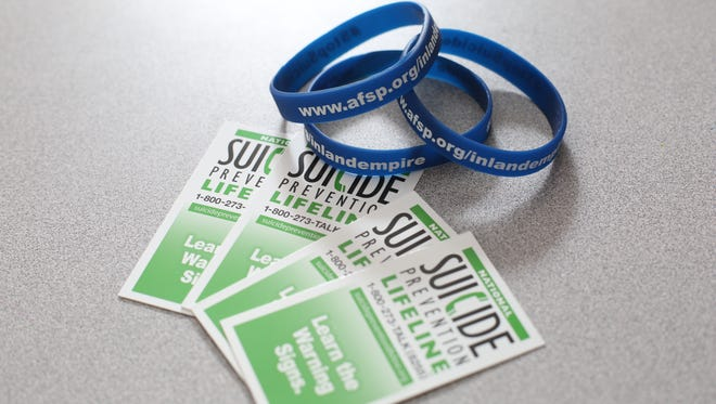 Bracelets and cards with suicide prevention contact information.