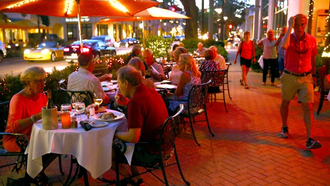 People eat dinner outside at Bistro 821 on 5th Avenue in Naples in November 2015. Tourism officials and rental property owners are under the impression that season is starting earlier than usual this year.