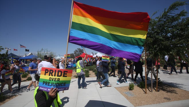 Member of the community participate in the first annual Pride Festival march in the city of Coachella in support of the LGBTQ community of the Eastern Coachella Valley at Veteran's Park on May 6, 2017.