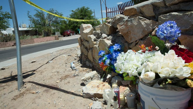 A small memorial sitting at the corner of Valley View and Winters where two people were run over by an SUV early Sunday Morning. Monday, May 8, 2017.