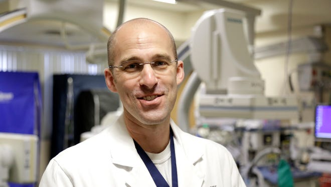 Neurosurgeon Dr. Matthew Lawson poses in the cath lab at TMH May 1.