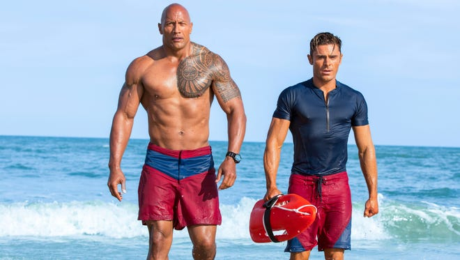 This image released by Paramount Pictures shows Dwayne Johnson, Left, and Zac Efron in a scene from, .Baywatch,' in theaters May 25.