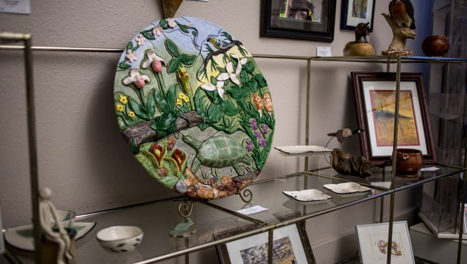 A large tile by artist Jane Barden is displayed at Studio 1219 in downtown Port Huron. Several of Studio 1219's artists will be at Art Hop locations this Friday to do demonstrations and talk about their art. Art Hop runs from 6 p.m. to 9 p.m May 12.