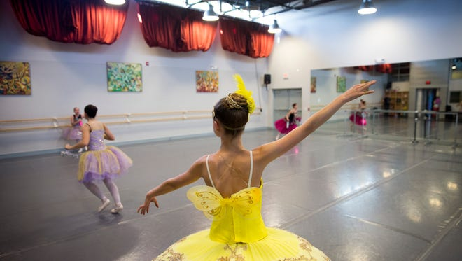 """Naomi Babcock, 15, center, rehearses the role of the Carefree Fairy on Monday for Naples Ballet 's """"Sleeping Beauty."""""""