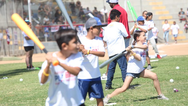 Children participate in a Major League Baseball funded clinic for kids in Indio on May 13, 2017 at the Davis Sports Complex in Indio.