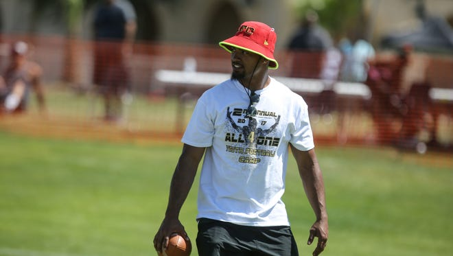 DJ Alexander, the Kansas City Chiefs linebacker, works with kids at a football camp at Xavier College Preparatory on Saturday, Mary 13, 2017 in Palm Desert.