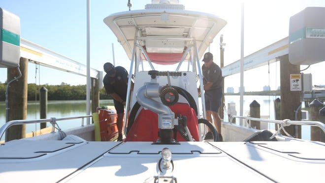 Firefighters Ben Bogacz and Vince Perkins prepare the Bonita Springs Fire Control and Rescue District boat to launch from the Little Hickory Island station.