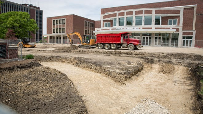 Construction crews continue to work on the Emens Auditorium lawn and facade May 17 at Ball State University. Emens awarded the contract for front lawn enhancements following the recent construction.
