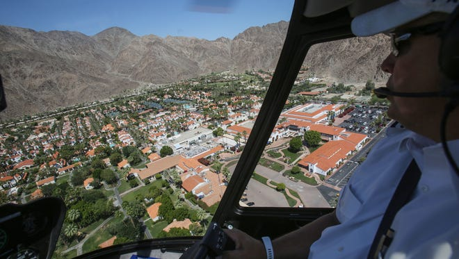 Christopher Cheek, president/chief pilot of Big Blue Air, flies over the La Quinta Resort and Club on Wednesday, May 17, 2017.