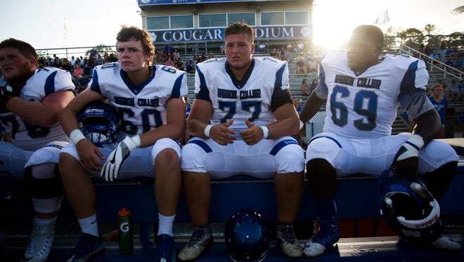 Barron Collier Cougars sit on the sidelines during the game against South Fort Myers on Friday, May 19, 2017 at Barron Collier High School in North Naples.