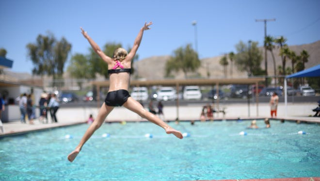 Mikayla Dewitt, 7, jumps into Wardman Park Pool in Desert Hot Springs on Saturday, May 20, 2017.