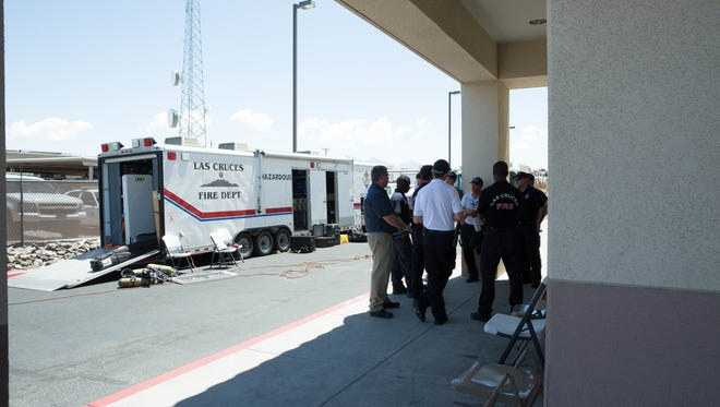 Las Cruces Fire Department's Hazardous Materials Response Team debriefs at Walgreens, next to the Las Cruces Border Patrol station, where they were investigating an unknown substance. The substance was later found to be non -hazardous, Monday May 22, 2017.