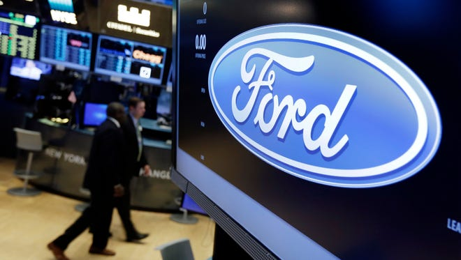 The logo for the Ford Motor Company appears above a post on the floor of the New York Stock Exchange on May 16, 2017.