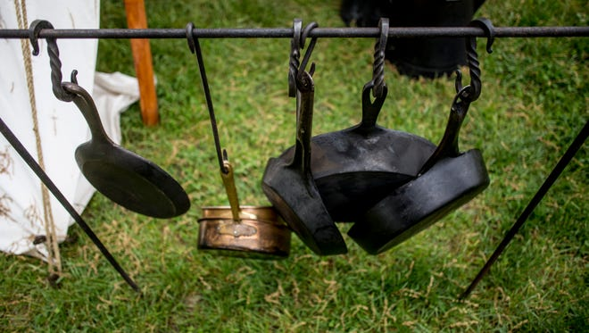 Iron pans are seen hanging near a fire pit in preparation of Feast of the Ste. Claire  Friday, May 26, 2017 at Pine Grove Park in Port Huron.