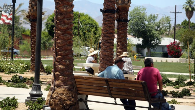 People enjoy their day at a park in downtown Coachella on Saturday, May 27, 2017.