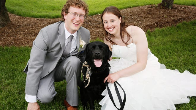 Alexander Heritier and Madeleine Erba with ring bearer Daisy on Saturday in Ypsilanti, Michigan.
