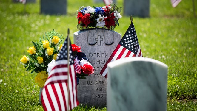 A grave is decorated for a past year's Memorial Day observance.