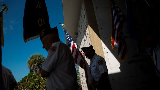 Veterans and family members of those who lost loved ones while serving gather for a Memorial Day service at the Naples Memorial Gardens at Hodges Funeral Home on Monday, May 29, 2017.