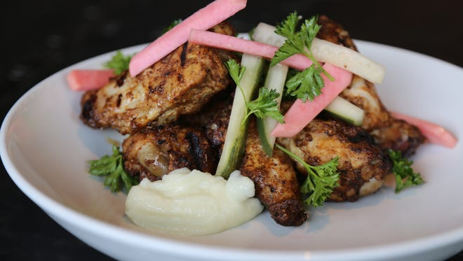 Chicken shawarma wings with pickles and toum ($9) from Livernois Tap, debuting at 567 Livernois in Ferndale June 3, 2017.