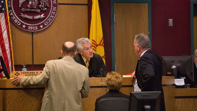 Judge Fernando Macias speaks with Doña Ana District Attorney Mark D'Antonio,right, and defense attorney Jess Lilley,left, during the trial of Leo Molina for the murder of Gregory Fernandez, June 1, 2017.