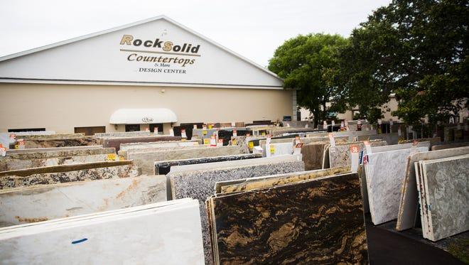 A large selection of sample countertops sits in front of Rock Solid Countertops in North Naples on Friday, June 2, 2017.