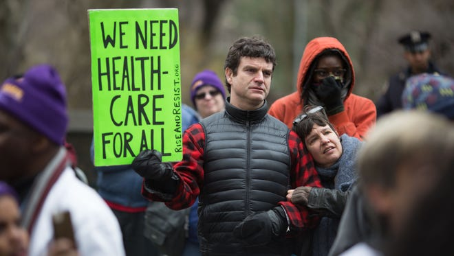 Health-care activists lift signs promoting the Affordable Care Act during a rally April 1, 2017, in front of Trump Tower in New York City as part of a national March for Health movement.