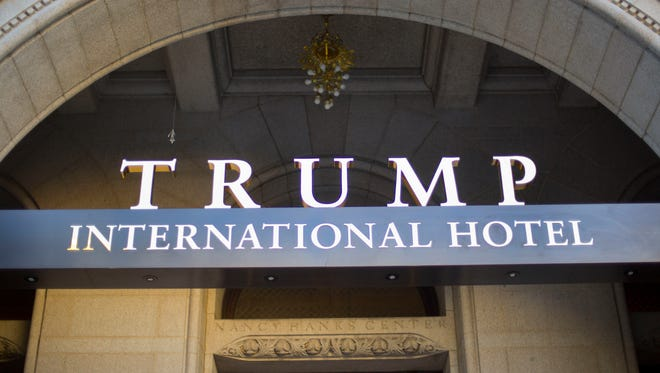 FILE - This Monday, Sept. 12, 2016, file photo, shows the exterior of the Trump International Hotel in downtown Washington. The Trump Organization says it will not ask guests at its hotels and resorts if they are using money from foreign governments to pay their bills, setting up a possible showdown with Democrats who accuse the president of violating the U.S. Constitution. (AP Photo/Pablo Martinez Monsivais, File) ORG XMIT: NYBZ346