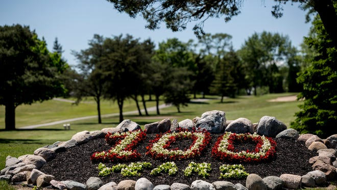 "A flower bed spells out ""100 Years"" as pictured Wednesday, June 7, 2017 at the St. Clair Golf Club."
