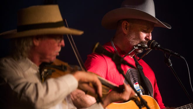 Raiford Starke, right, plays with J. Robert on Monday, June 5, 2017 at the Marco Players on Marco Island during the Florida Songwriters Showcase.