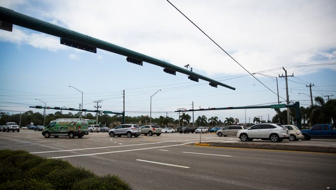 Cars turn onto Livingston Road from Pine Ridge Road on Wednesday, June 7, 2017 in North Naples.