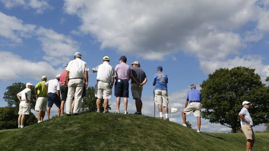 Spectators on the 17th hole during the 100th Met Open