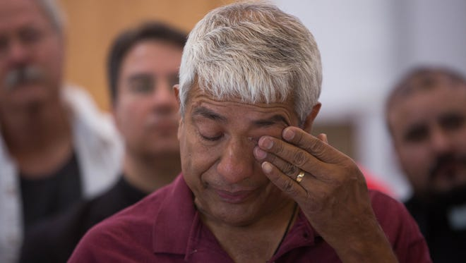 Jorge Taborda, wipes tears from his face during a press conference put on by  Comunidades en Acción y de Fé at the Holy Cross Retreat. Saturday, June 17, 2017 at the Holy Cross Retreat Center. Taborda is being housed at the retreat center after his wife was detained and deported from the U.S.