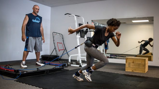 Owner Rodney Glassnor works with his daughter Mya Rhodes, 18, as she does run outs Friday, June 23, 2017 at Blue Water Express Training Center in the St. Clair Riverview Plaza.