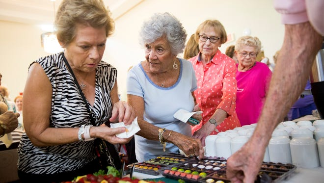 Residents of the Carlisle Naples sample chocolates made by Norman Love Confections after the internationally renowned chocolatier spoke at the residence Thursday, June 22, 2017 in Naples.