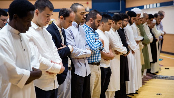 Muslims celebrate Eid al-Fitr, the end of Ramadan, in group prayer on Sunday, June 25, 2017, at East Naples Middle School. Ramadan is the ninth month of the Islamic calendar and is observed by fasting from sunrise to sunset, prayer, and spiritual reflection and growth.