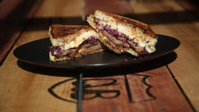 The Reuben sandwich from KUMA Catering's pop-up restaurant at the Coachella Valley Brewing Company is a hearty option.