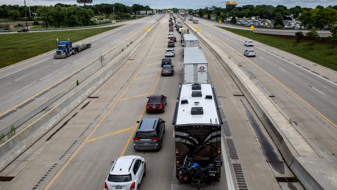 Traffic to the Blue Water Bridges is seen backed up past Water Street Friday, June 23, 2017 in Port Huron.