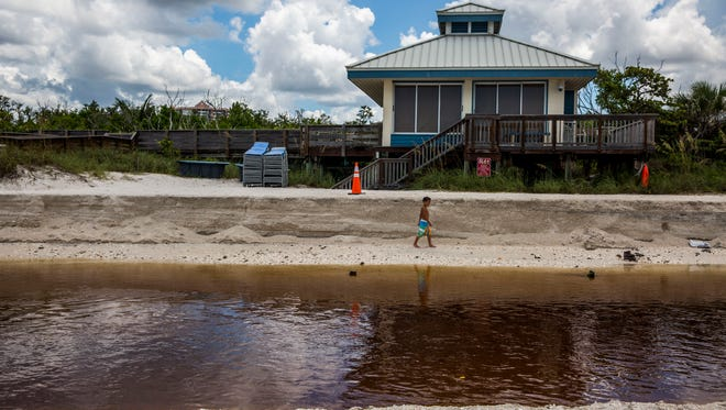 Beachgoers spend an afternoon at Clam Pass Park in North Naples on Wednesday, July 5, 2017. Clam Pass is at risk of filling with sand and closing up.