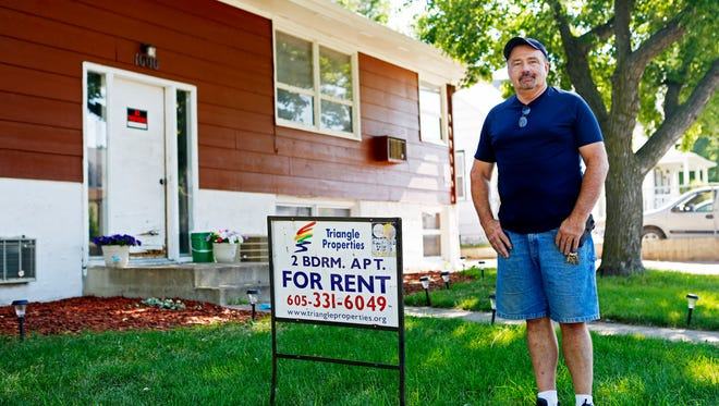 Larry Schut, a landlord in Sioux Falls, stands in front one of his rental properties. Schut has had trouble keeping tabs on his tenants since the passage of Marsy's Law last year.