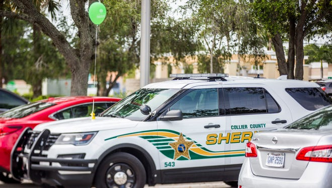 Collier County Sheriff's Department talks with members of the community about leaving valuables in the car and locking the doors in Riverchase Shopping Center in North Naples on Friday, July 7, 2017. CCSO is leaving green balloons on their cars to try to signal open communication with the community.