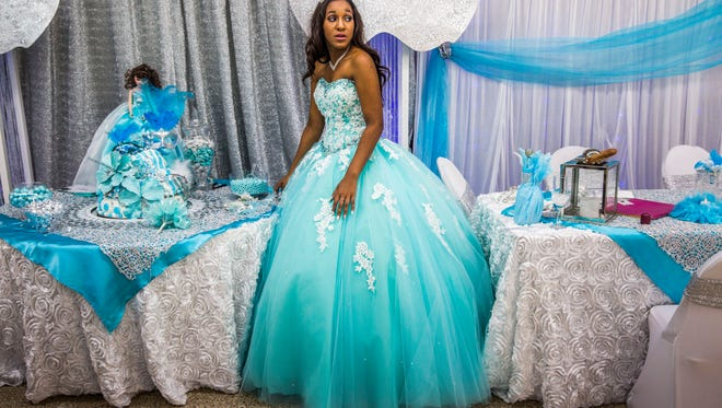 Lizbeth Lebron of Lehigh Acres celebrates her Quinceañera in North Fort Myers on Saturday, July 8, 2017.