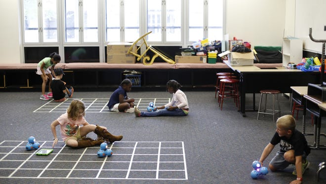 Kindergarten through second graders play with robots that they will learn to program at Florida State University Schools Coding and Robotics Science Camp July 10.