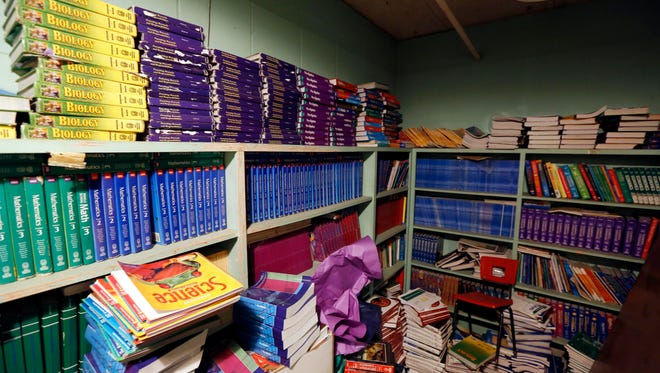Old textbooks that education officials say can't be used because they don't line up with Mississippi's Common Core State Standards are kept in a storage closet Oct. 23, 2014 in Durant, Miss.